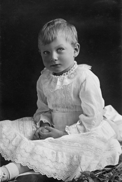 Prince John of Wales (1905-1919), youngest son of King George V and Queen Mary, pictured here wearing a dress