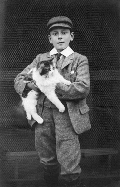 Prince Maurice of Battenberg (1890-1914), youngest son of Princess Beatrice and Prince Henry of Battenberg, pictured holding a cat
