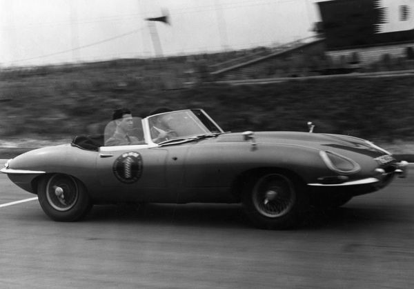 Nineteen year old Prince Michael of Kent (born 1942) driving at 100mph in an E-type Jaguar at Brands Hatch race track in April 1962
