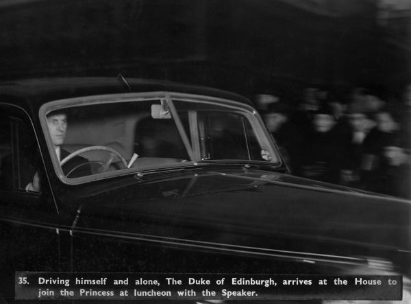Prince Philip, Duke of Edinburgh driving himself alone to the Houses of Parliament where he was to join Princess Elizabeth (Queen Elizabeth II) for lunch with the Speaker