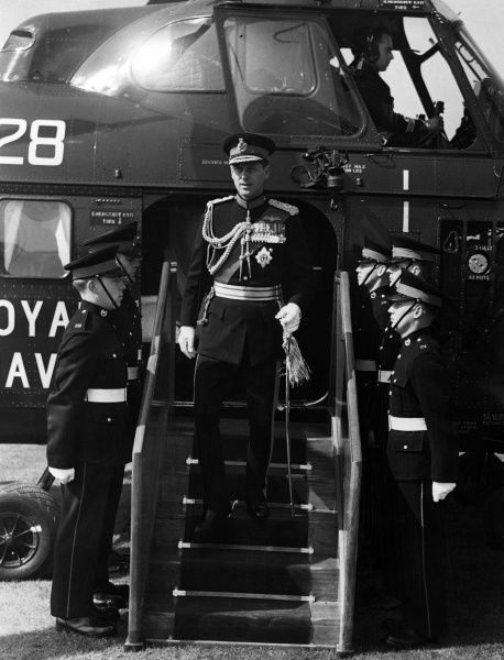 Prince Philip, Duke of Edinburgh (born 1921), as Captain General of the Royal Marines arriving by helicopter at Eastney Barracks, Portsmouth where he presented new colours to the Royal Marine Corps. Date: 1956