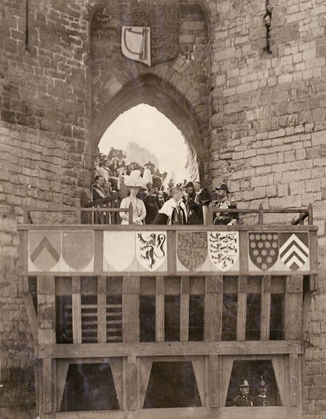 Investiture of the Prince of Wales (later Edward VIII) at Caernarvon. Here he is being presented by his parents, King George V and Queen Mary, at Queen Eleanor's Gate