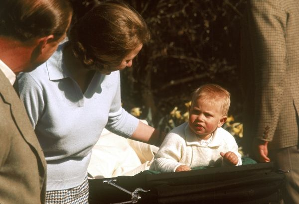 One year old Prince Edward (Earl of Wessex) in his pram with his elder sister, Princess Anne paying him attention while his father, Prince Philip, Duke of Edinburgh looks on. Taken at Frogmore on 13 April 1965. Date: 1965
