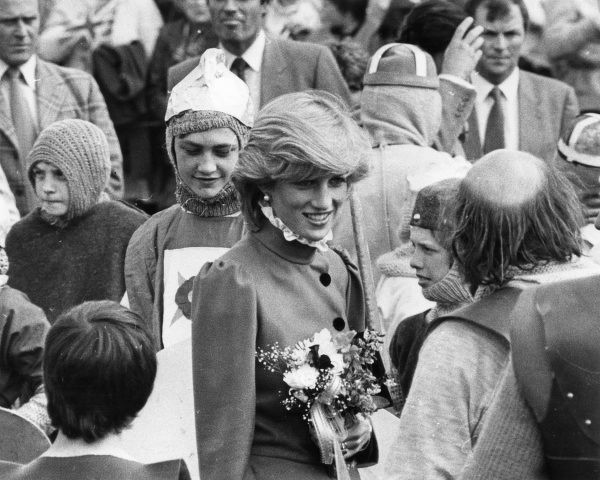Diana, Princess of Wales talks with cast members of the 650 Pageant at the Recreation Ground during a visit to St. Columb, Cornwall. Date: circa mid-1980s