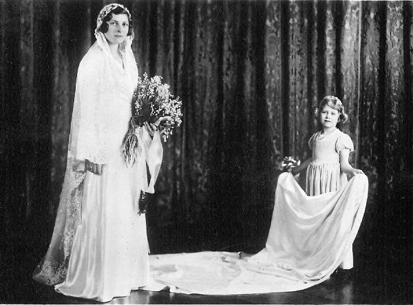 Lady May Cambridge (Princess May of Teck), with her bridesmaid Princess Elizabeth of York, later Queen Elizabeth II. On 24th October 1931, Lady May, Prince Leopold's granddaughter, married Sir Henry Abel Smith at Balcombe in Sussex