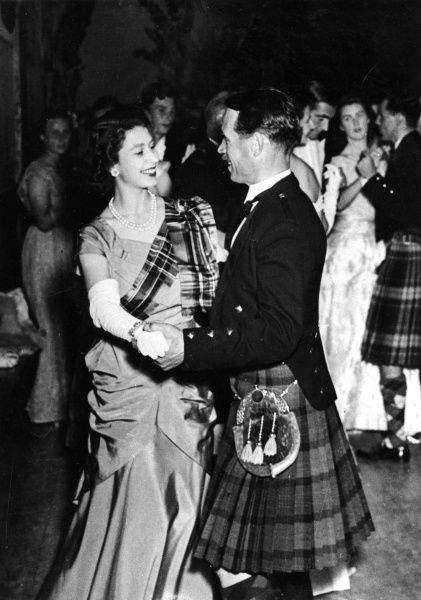 Princess Elizabeth wearing a gown of lime green with a royal stuart tartan sash, is seen dancing a quick-step at the Aboyne Ball(held in the Victory Hall, Aboyne, Aberdeenshire)