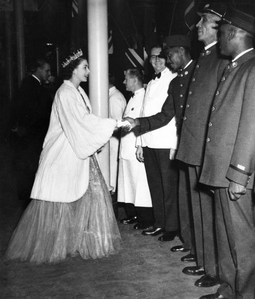 Princess Elizabeth (Queen Elizabeth II) shakes hands with the train porters as she takes leave of the royal train and its crew at Charlottetown, Prince Edward Island during the Royal Tour of Canada in 1951. Date: 1951