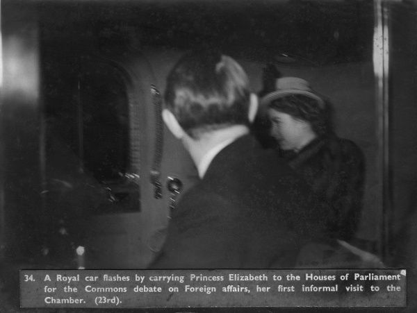 Princess Elizabeth (later Queen Elizabeth II) glimpsed inside a royal car transporting her to the Houses of Parliament for a Commons debate on foreign affairs, her first informal visit to the Chamber