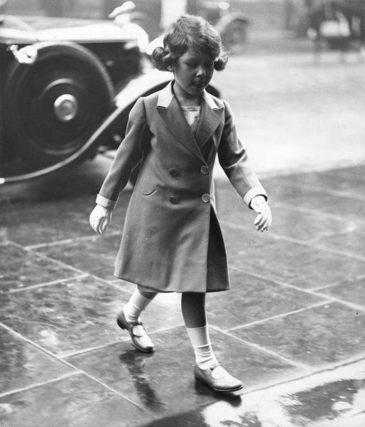 Photograph of Princess Elizabeth of York (now Queen Elizabeth II) taken in May 1932, arriving at the Royal Tournament