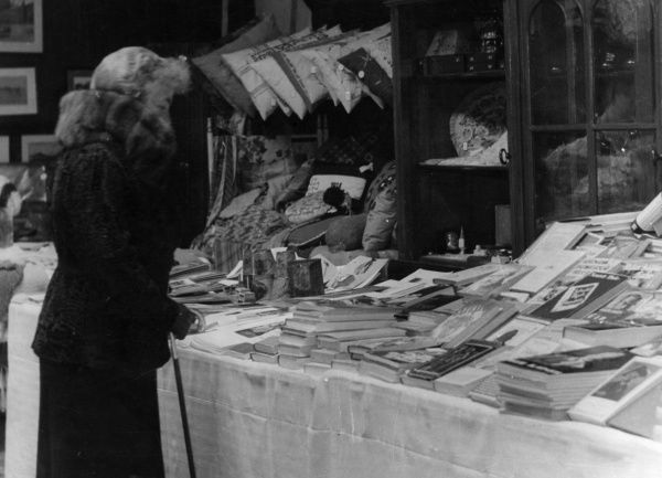 Princess Hermine Reuss of Greiz (1887-1947), second wife of the deposed Kaiser Wilhelm II. Seen here at a bookstall in Doorn, Netherlands, possibly at a charity event (she herself apparently did charitable relief work). Date: circa 1930s