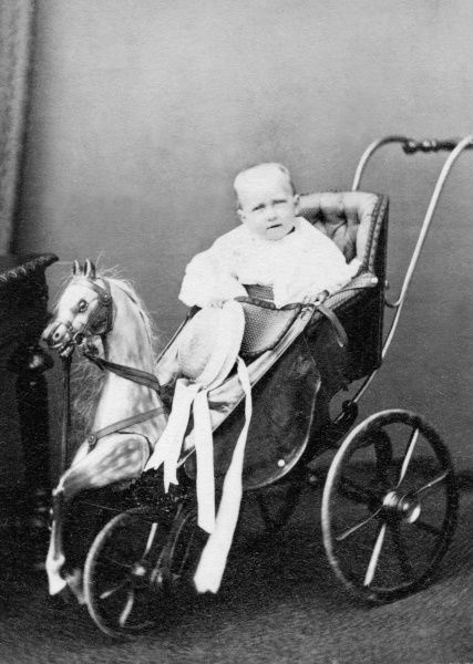 Princess Louise of Wales, Princess Royal, later Duchess of Fife (1867-1931) seen as a baby sitting in a horse-drawn baby carriage, or pram. Princess Louise was the third child and eldest daughter of King Edward VII and Queen Alexandra