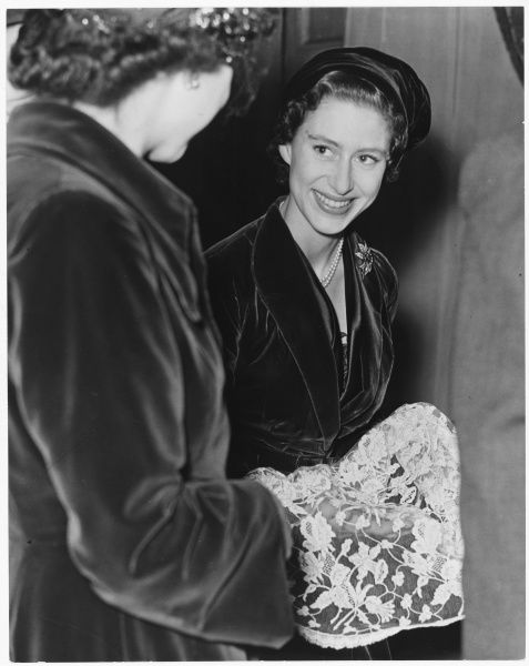 PRINCESS MARGARET Inspects nylon lace used in a ballgown designed by the fashion designer, Victor Stiebel, a favourite designer of the princess. Date: 1930-2002