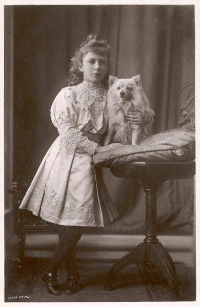 Princess Mary, daughter of George V, later countess of Harewood, poses with her dog