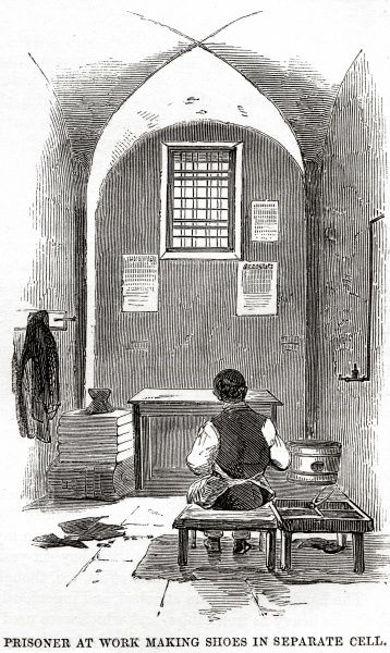 Prisoner at work making shoes in cell at Millbank Prison, London. Date: 1862