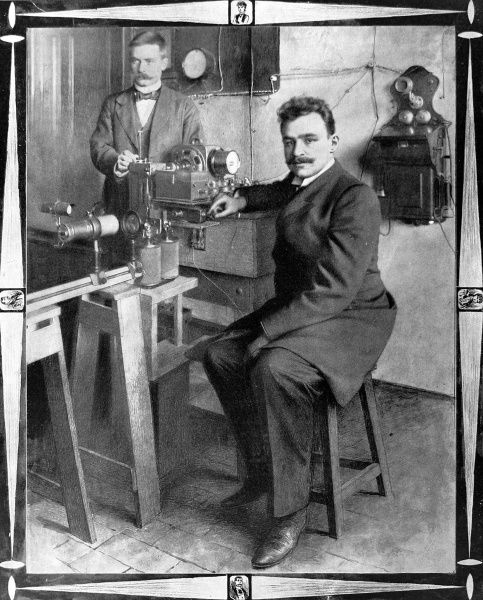 Professor Arthur Korn with his tele-photographic apparatus. Korn developed a method of transmitting photographs through telephone wires. In 1907 he produced the first facsimile telegraph