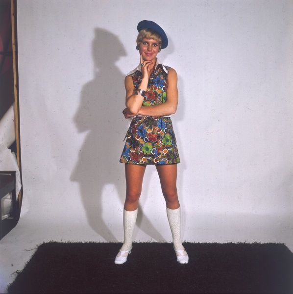 A colourful 'Pyschadelic' mini dress, worn with a blue beret and white patent leather boots - So Sixties! Date: 1968