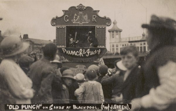 A crowd gather to watch a Punch and Judy show in Blackpool