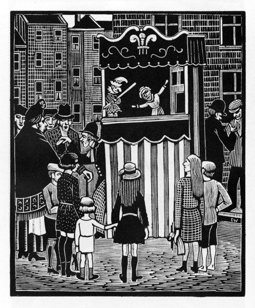 Children gather to watch a Punch and Judy show