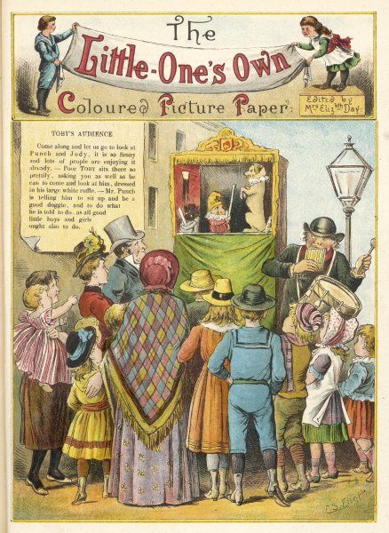 Grown-ups and children gather round a Punch & Judy in the street