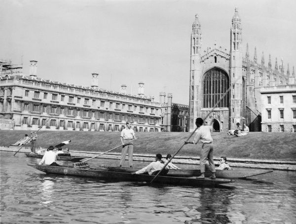 A group of people punting on the River Cam at Cambridge, with King's College Chapel in the background