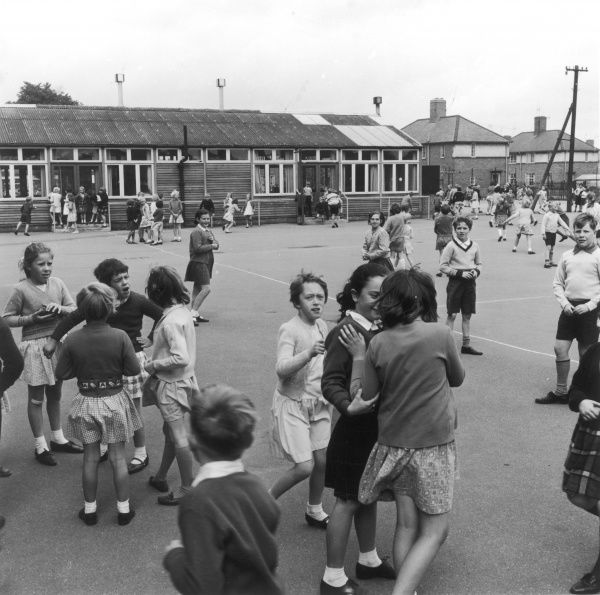 Pupils in a school playground, St Luke's C of E Primary