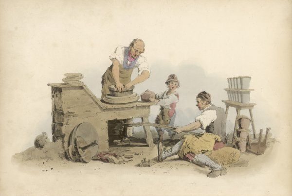A POTTERY A potter and his assistant making red pottery, with a young boy to help