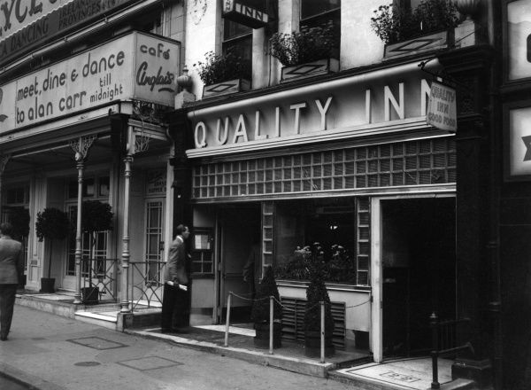 Quality Inn, next to Cafe Anglais on The Strand, London. Date: 1947