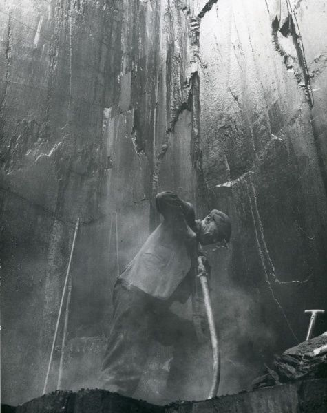 A quarryman drilling into the rock at Penyrorsedd Slate Quarry, Nantlle Valley, Caernarvonshire (now Gwynedd), North Wales