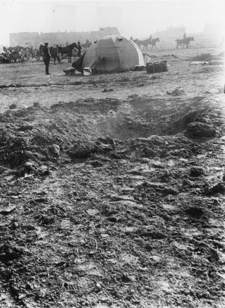 A Quartermaster's tent on a transport field during the First World War, showing a hole in the foreground made by a shell which fell within twenty yards but did no damage. Date: 1916