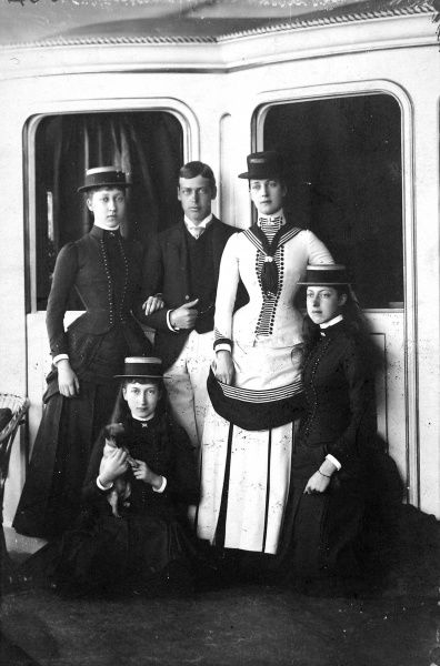 Photograph from 1884 showing Queen Victoria with four of her children: from left, Princess Louise, Princess Maud (seated), Prince George (later George V), Queen Alexandra and Princess Victoria