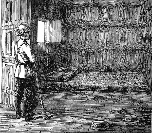 A British soldier enters the empty bedchamber of the Queen of Ashanti which has a bed on the floor and is nowhere near as grand an affair as the King's bedchamber