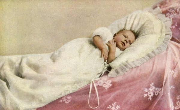 Colour photograph of Princess Elizabeth of York (Queen Elizabeth II) as a young baby. She was born at 17 Bruton Street on 21st April 1926 and christened at the Private Chapel, Buckingham Palace on the 29th May. Date: 1926