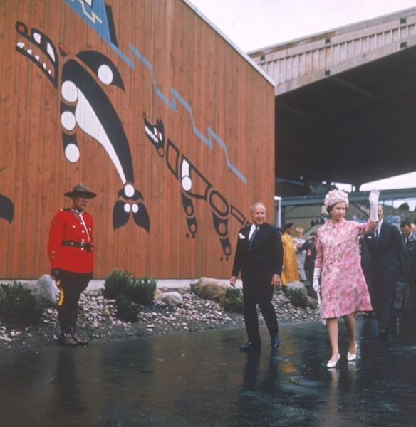 Queen Elizabeth II waves to crowds as she visits the Montreal Expo 1967 during the royal tour of Canada in 1967. She is accompanied by Prime Minister, Lester Pearson. Date