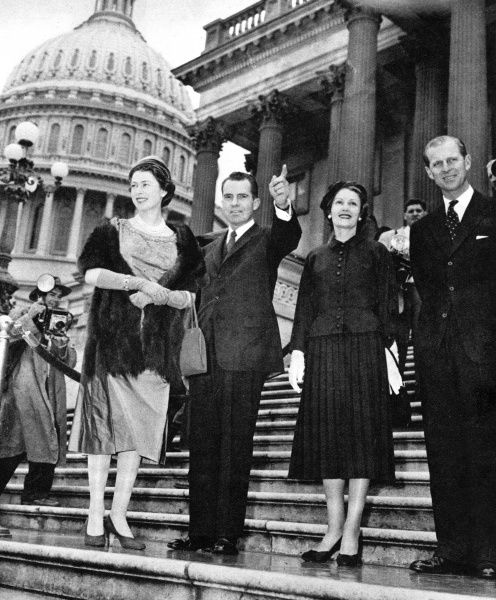 The royal visit to North America,1957. Vice president Nixon points out the surrounding landmarks on the steps of the Capitol to Queen Elizabeth II, who looks in the opposite direction. Mrs. Nixon stands next to the Duke of Edinburgh. Date: 1957