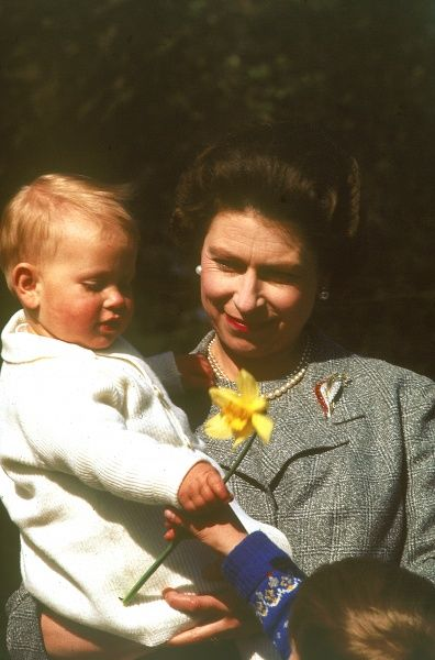 Queen Elizabeth II holding a one year old, Prince Edward (Earl of Wessex) at Frogmore in April 1965. Date: 1965