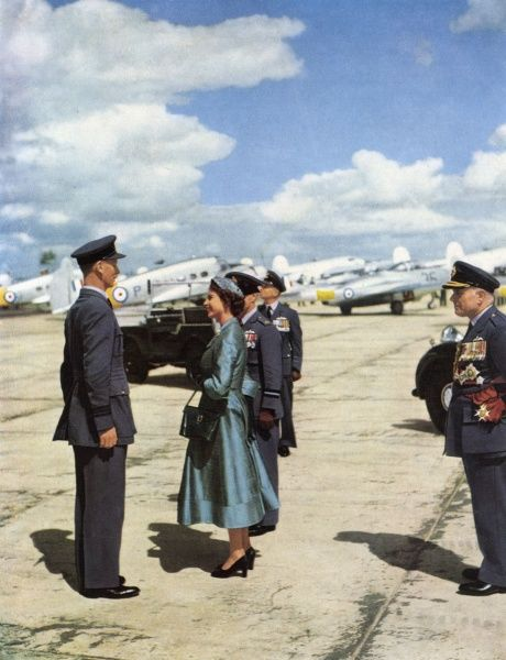Queen Elizabeth II on her tour of inspection during the RAF Coronation Review at Odiham, Hampshire in July 1953. She is pictured talking to Observer Commander, E. J. B. Irving of the Royal Observer Corps, and behind her is Air/Cdre.G. D. Stephenson