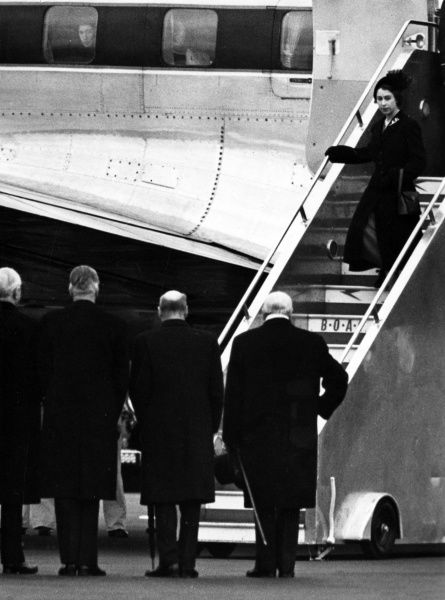 The new Queen Elizabeth II, dressed in black - mourning her recently deceased father King George VI - returns to the UK after cutting short her holiday in Kenya after receiving the news