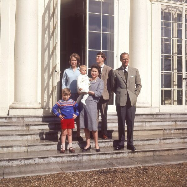 Queen Elizabeth II and family pose on the steps of Frogmore House in April 1965. From left, Prince Andrew looking cheeky, Princess Anne, the baby Prince Edward in the arms of his mother, the Queen, Prince Charles looking up at the sky and Prince Philip
