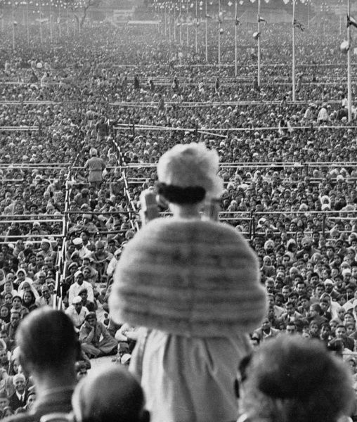 A vast crowd listening to Queen Elizabeth II give a speech in the Ramlila Grounds outside Old Delhi during the royal tour of India in 1961. The audience was estimated at 250,000. Date: 1961