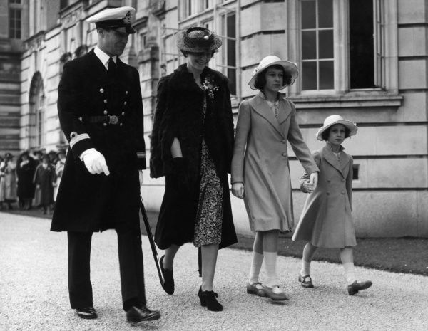 Thirteen year old Princess Elizabeth and her sister, Margaret Rose, accompanied by their governess, Marion Crawford attend a service at the college chapel at the Royal Naval College at Darmouth during a visit there by the royal family
