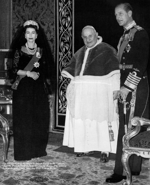 Queen Elizabeth II and Prince Philip, Duke of Edinburgh with Pope John XXIII in the throne room of the Vatican, the meeting coming at the end of a three day State visit to Rome in 1961. Date: 1961