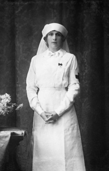 Queen Victoria Eugenie of Spain, formerly Princess Ena of Battenberg (1887-1969), second child and only daughter of Princess Beatrice and Prince Henry of Battenberg pictured in Red Cross uniform in about 1916