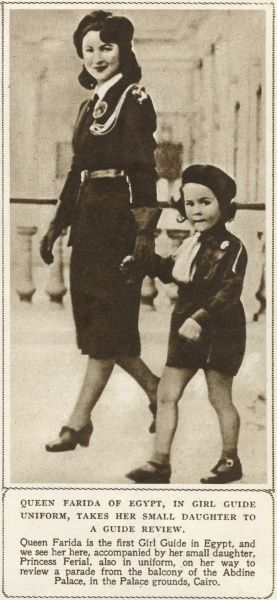 Queen Farida of Egypt(1921-1988), in girl guide uniform, taking her daughter Princess Ferial to a Guide parade,rom the Balcony of the Abdine Palace, in the Palace Ground, Cairo