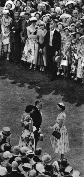 The Queen greets guests at her annual Garden Party. Date: 1955