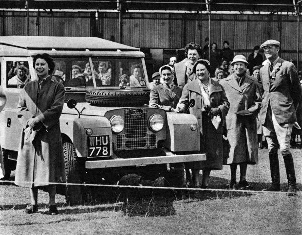 The Queen and other members of the Royal Family stand by a Land-Rover, with their host, the Duke of Beautfort, at the Badminton Three-day Horse Trials. Date: 1956