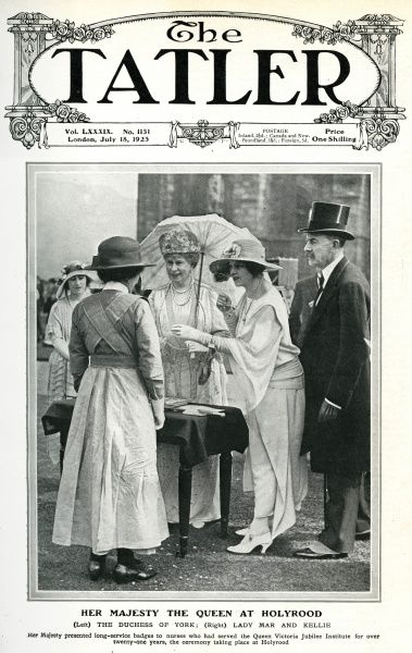 Her Majesty Queen Mary at Holyrood Castle with the Duchess of York (future wife of George VI and Queen Mother) and Lady Mar and Kellie, presenting badges to nurses who had served the Queen Victoria Jubilee Institute for over 21 years. Date: 1923