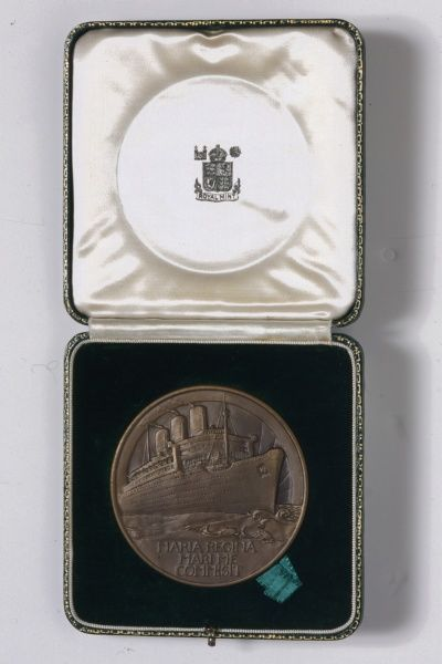 A commemorative medal made by the Royal Mint, marking the launch of the Queen Mary cruise ship in 1935