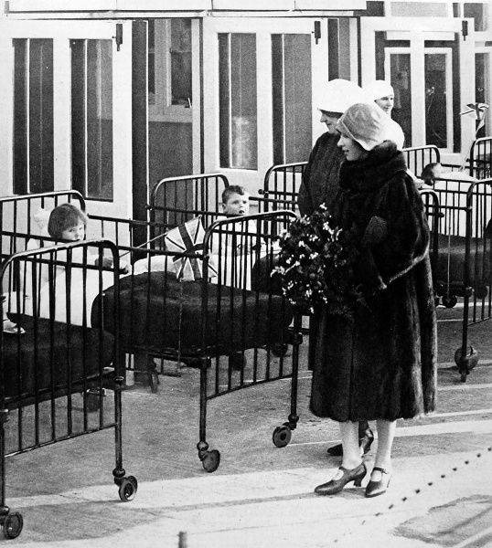 Princess Mary, accompanying Queen Mary on a hospital visit in 1928. George V suffered with illness during this period, with the Queen replacing him on frequent public engagements