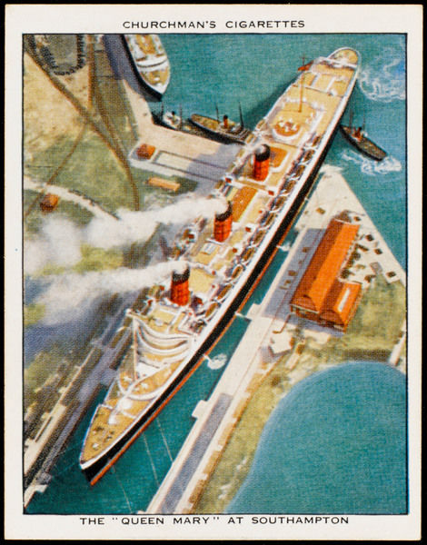 Seagull's eye view of the Cunard passenger liner as she prepares to slip her moorings and leave her dock at Southampton, assisted by two tugs