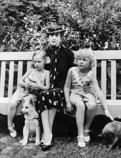 Queen Maud of Norway with her granddaughters, Ragnhild (left) and Astrid, in 1937. Maud's only child, Crown Prince Olav, married Princess Martha of Sweden in 1929: Ragnhild, always the smaller of their daughters, was actually the elder